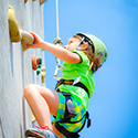 Child climbing a rock wall.